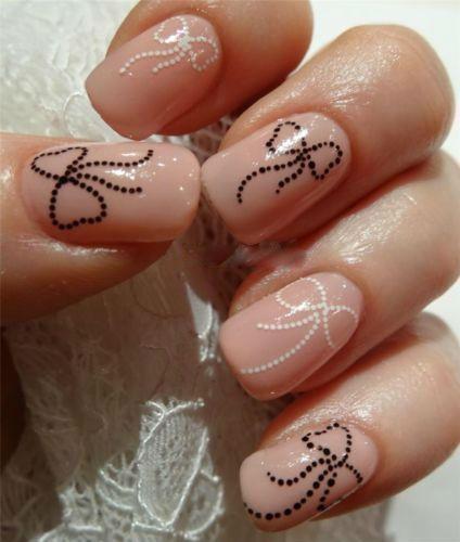 Дизайн бантики на ногтях фото